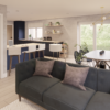 Open plan living area with view of dining area and kitchen with breakfast bar